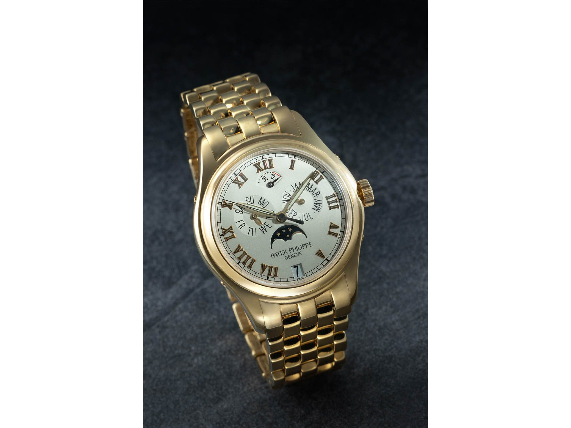 Patek Philippe, 18k Yellow Gold Ref. 5036/1j-001 Annual Calendar With Moon Phase Wristwatch.